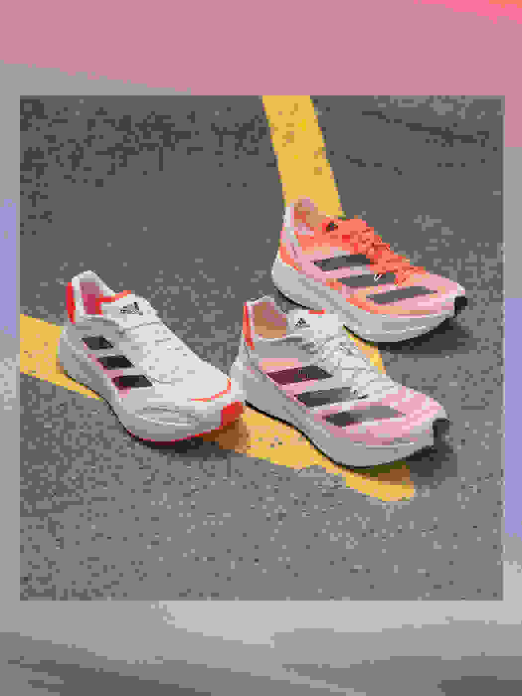 Adizero running shoes on the street with text