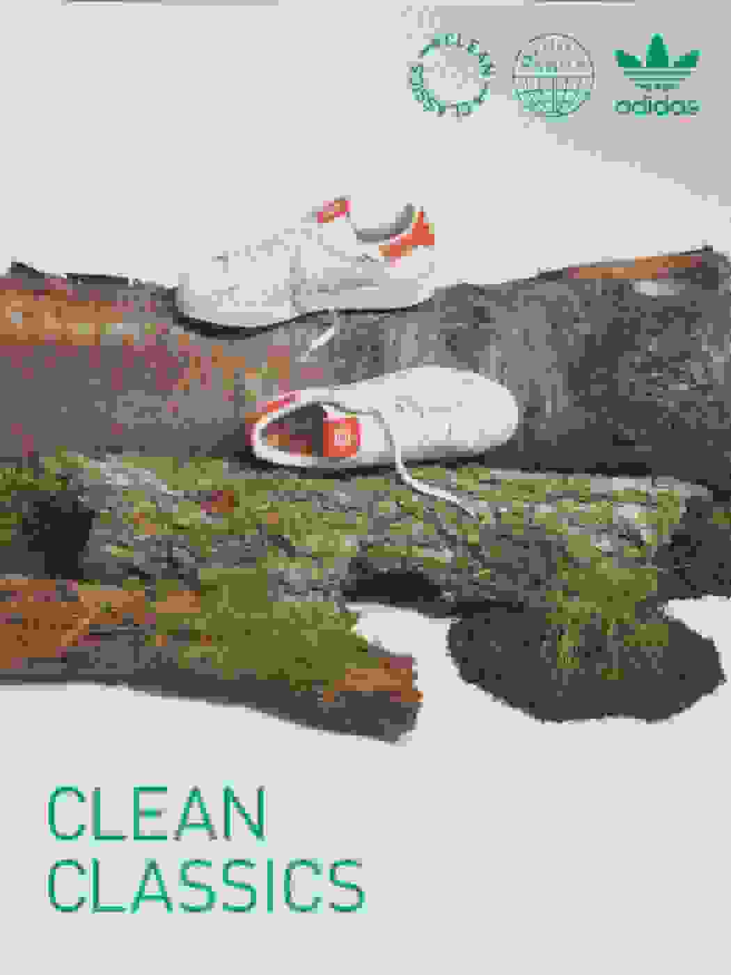 A pair of Superstar sneakers from the Clean Classics collection is perched on the trunk of a cut-down tree.