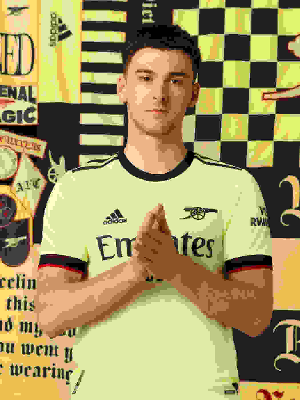 Male player wearing Arsenal Away Jersey