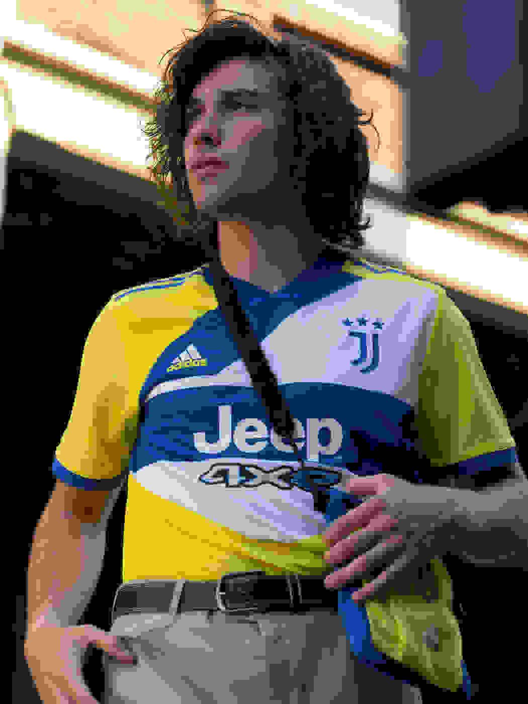 A male fan wearing the Juventus Third kit