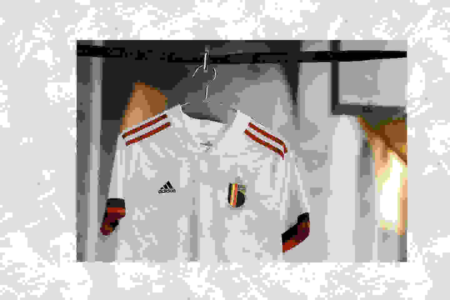 The new Belgium Away jersey is shown here. A modern masterpiece made for UEFA EURO 2020™, this adidas football jersey has an off-white design with red and black details.
