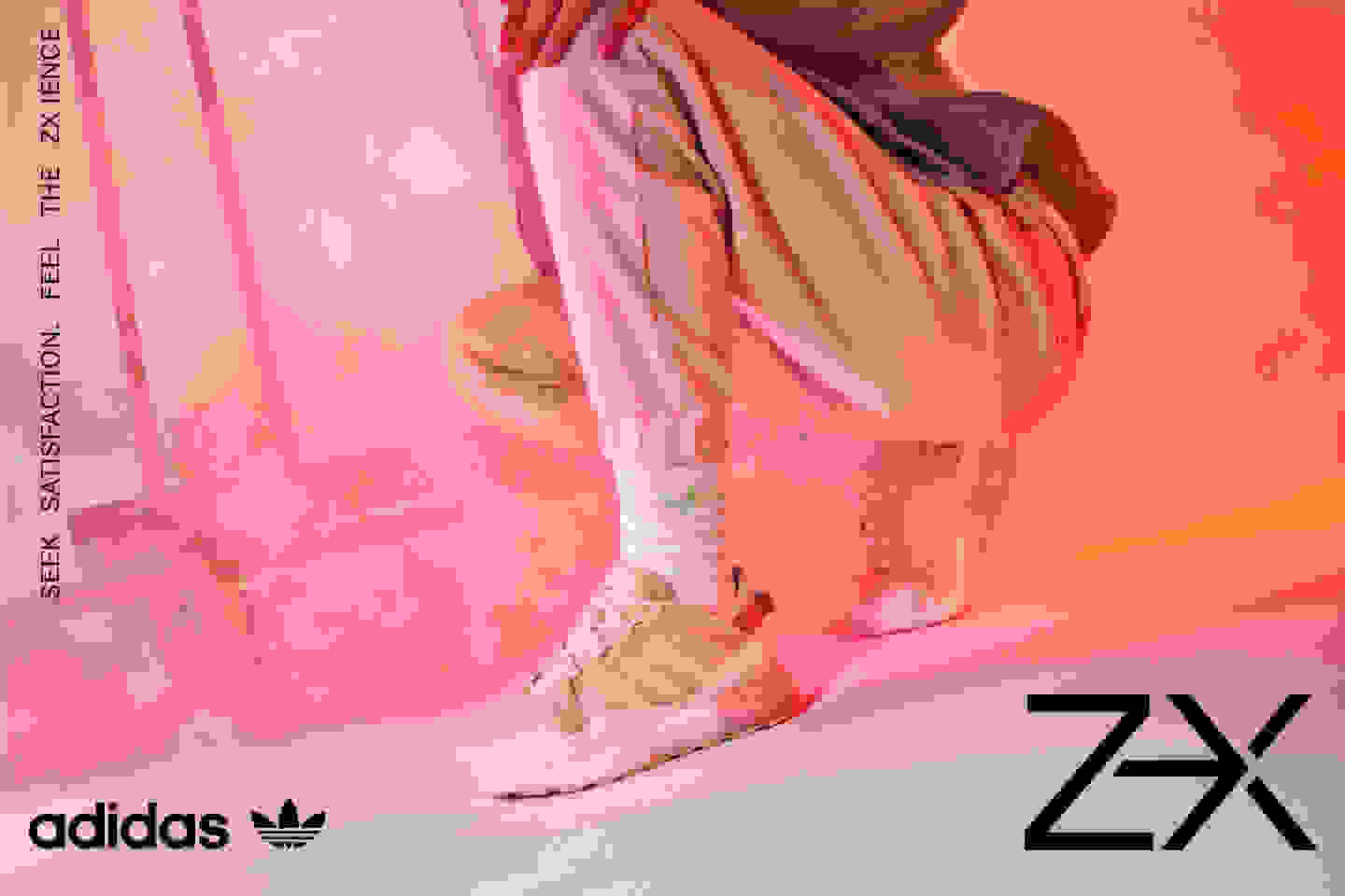 A crouching model wears a women's ZX 2K BOOST PURE shoe.