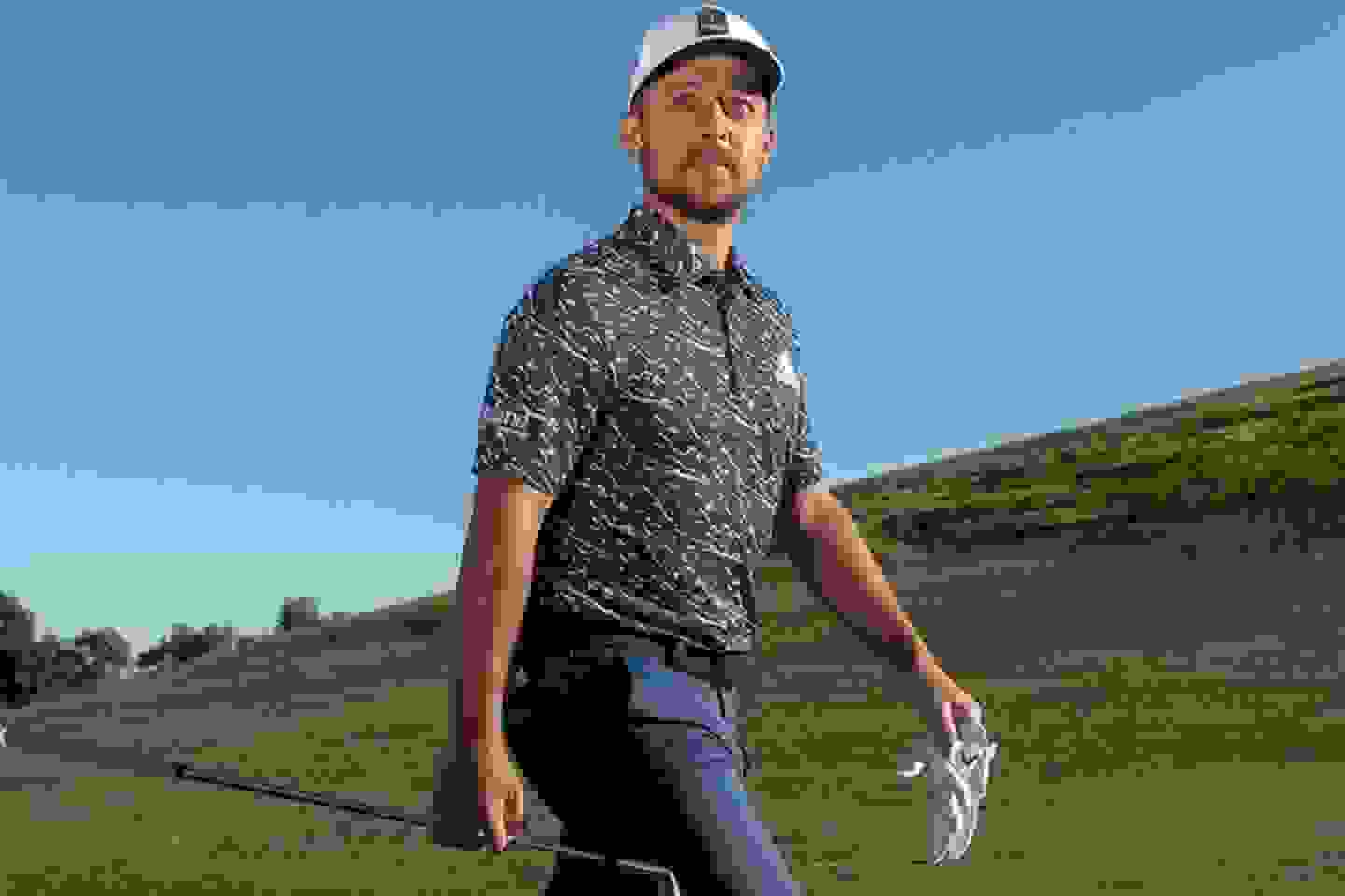 man playing golf wearing a polo