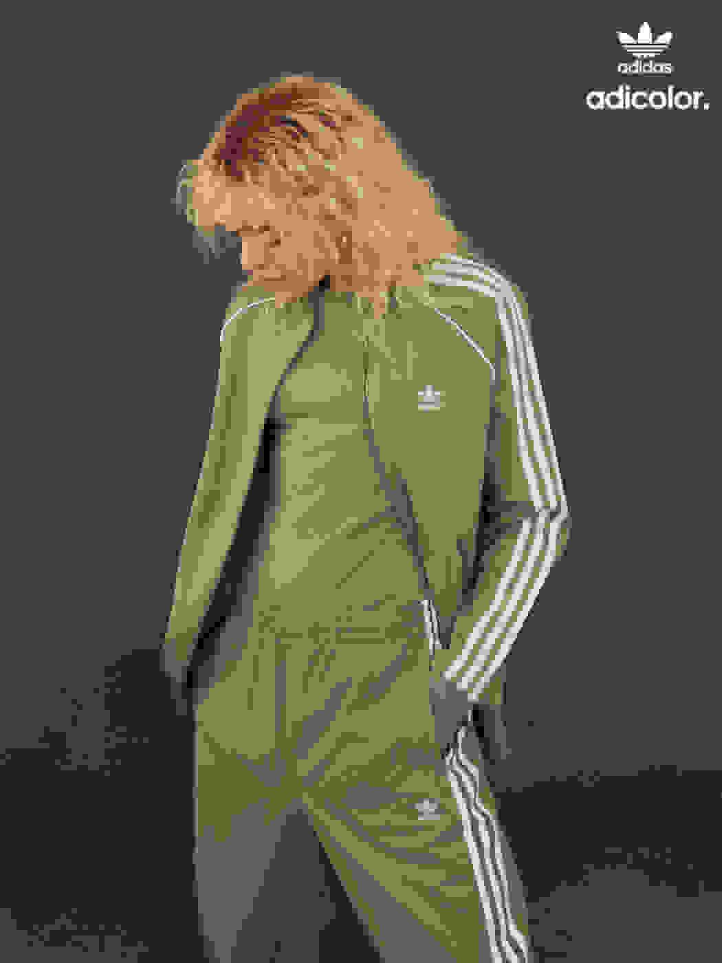 Woman wearing a stylish contemporary neutral colored tracksuit.