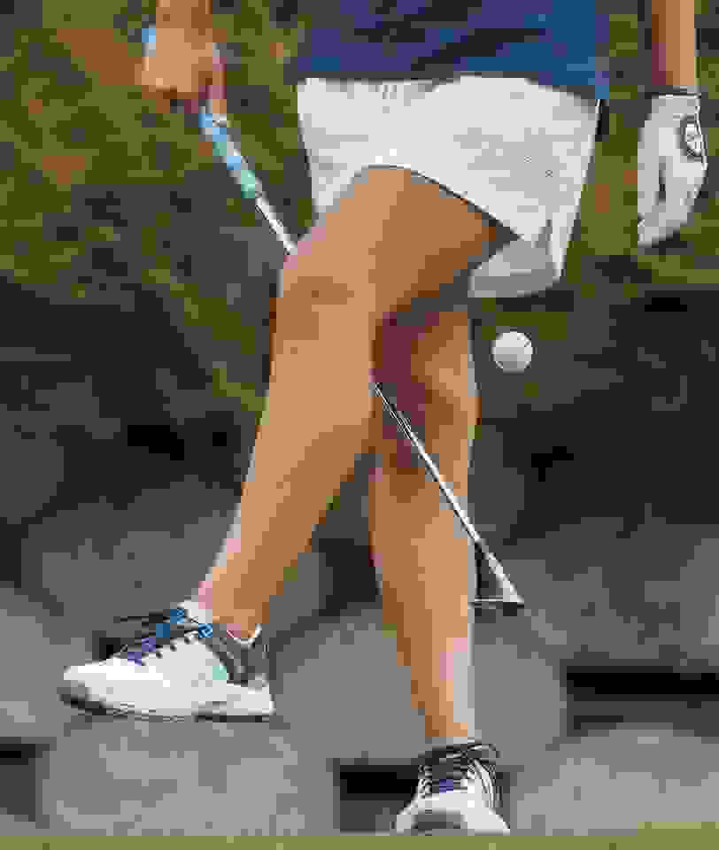 Close-up of woman playing golf