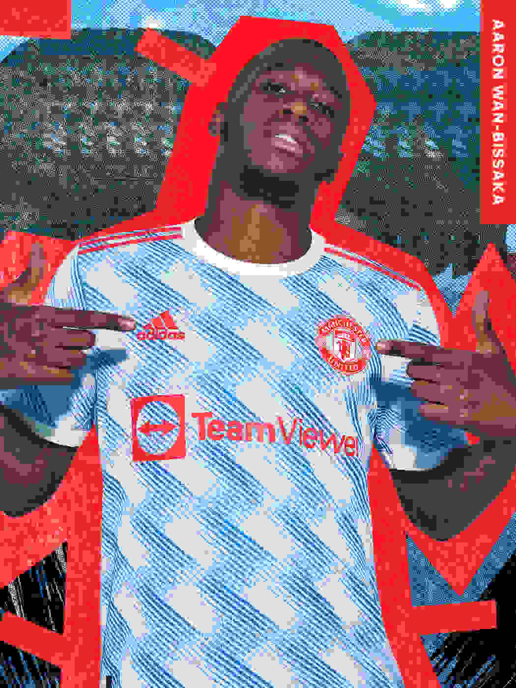 A male player wearing the Manchester United Away kit