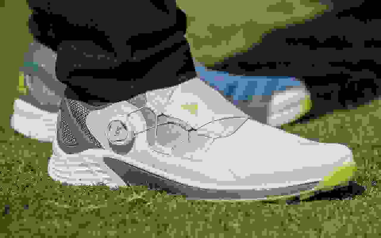 Close-up of golf shoe on court