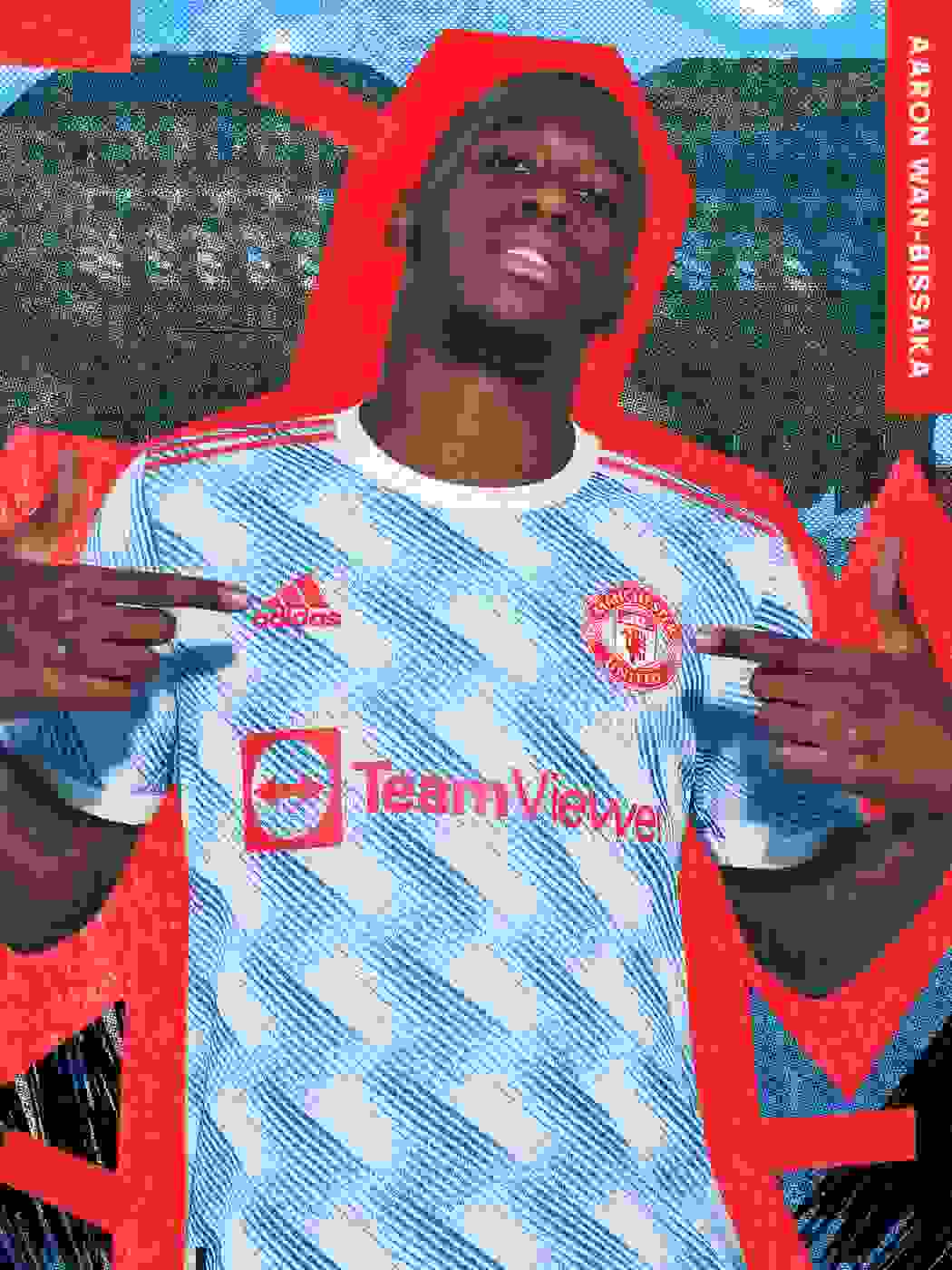 A male player wearing the manunited away jersey