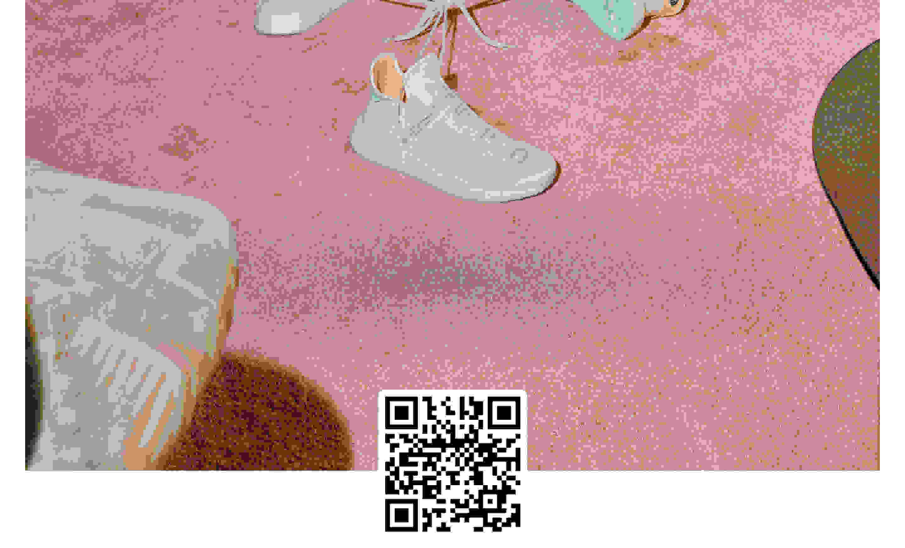 The HU NMD N.E.R.D. sits on a pink carpet. The chalk-coloured Primeknit upper with N.E.R.D. embroidery in English and Japanese is in focus.