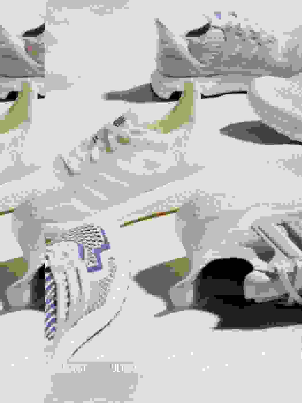Ultraboost Made to be Remade model displayed on brick with light-coloured background.