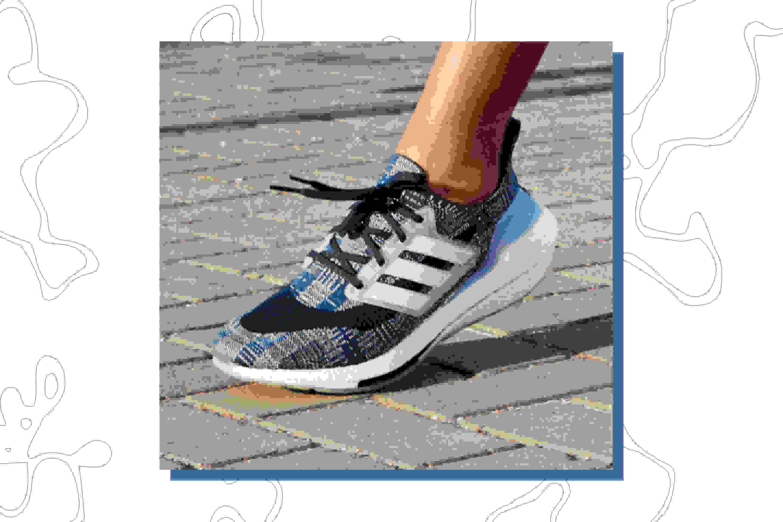A woman is wearing Primeblue Ultraboost 21 shoes