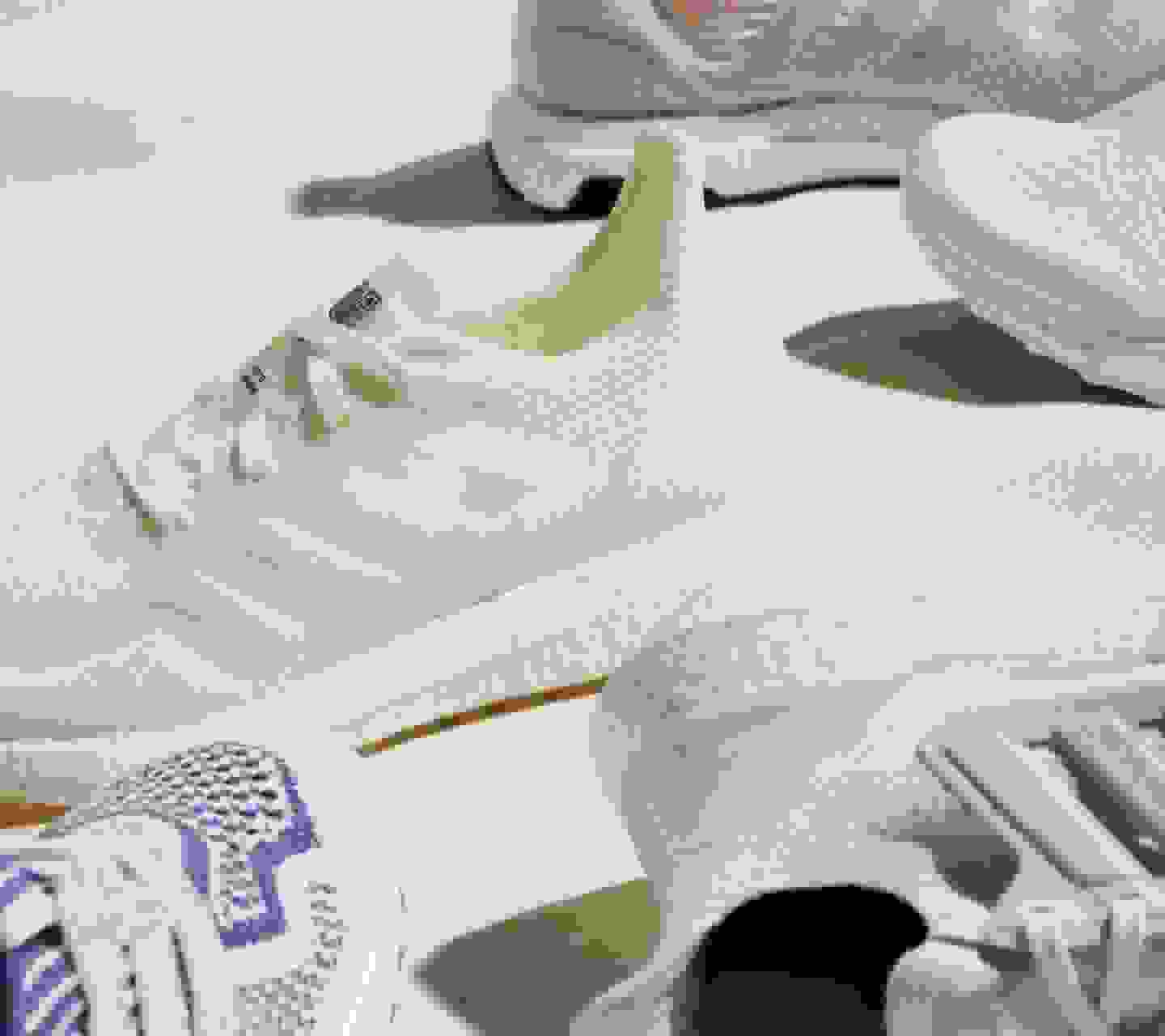 The SS21 sustainable Ultraboost models on a light surface with notable shadows.