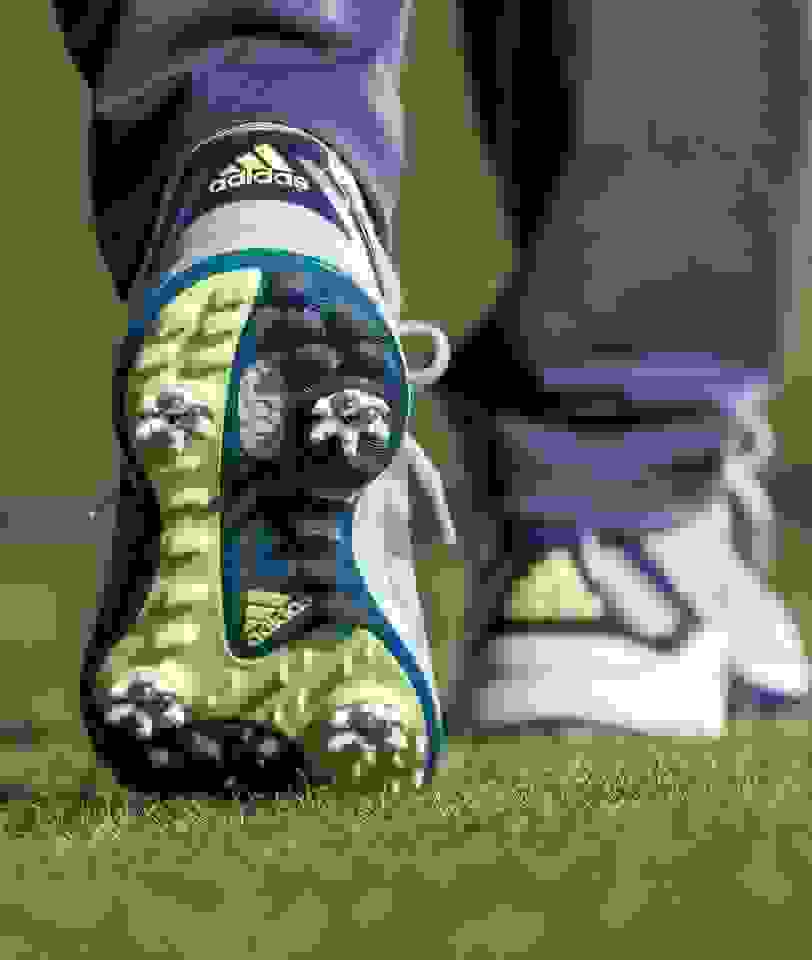 close-up of golf shoes on the coart