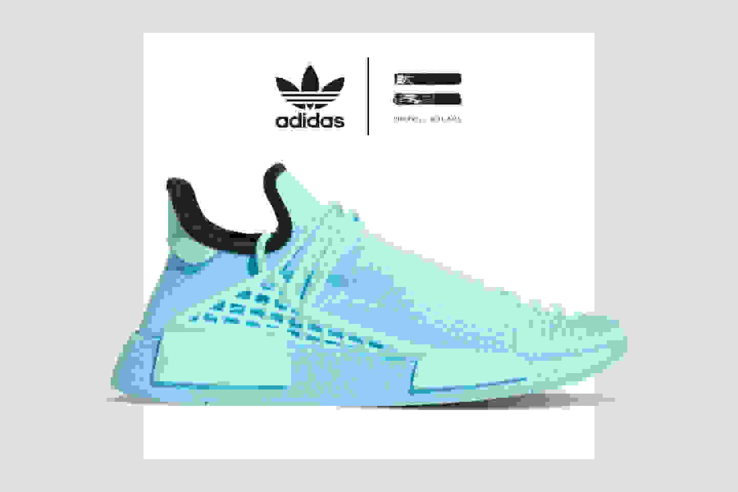 Sideview of an HU NMD Aqua shoe, highlighting the full-length Boost midsole, the midfoot lace cage, and the rope-style lacing system.