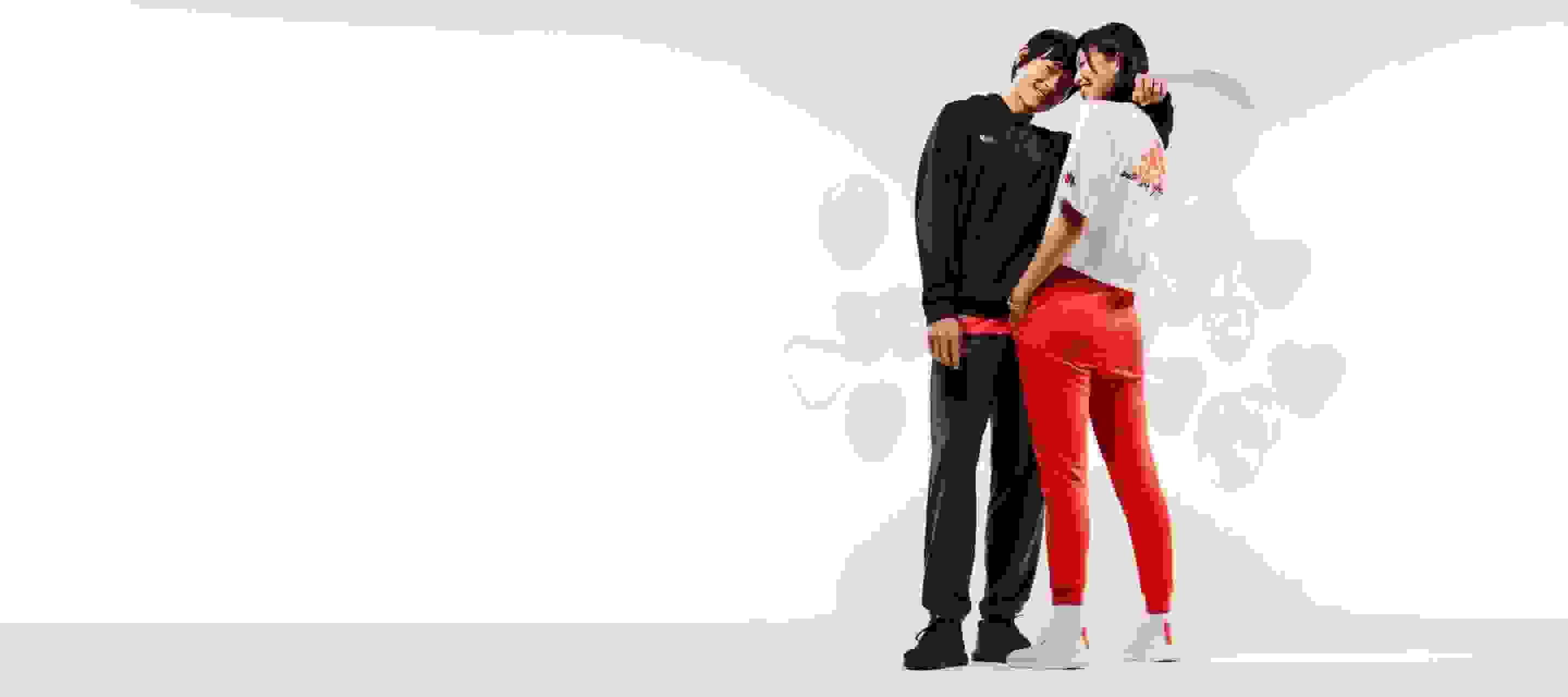 Young couples surrounded by heart shaped balloons, wearing the adidas Valentine's Day collection.
