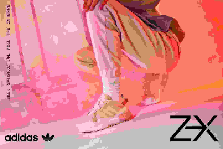 A crouching model wears a women's ZX 2K BOOST PURE shoe.