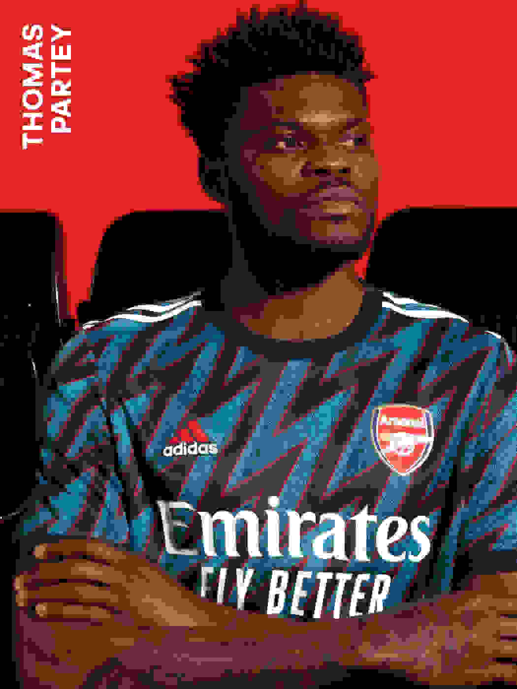 A male player wearing the Arsenal Third Kit