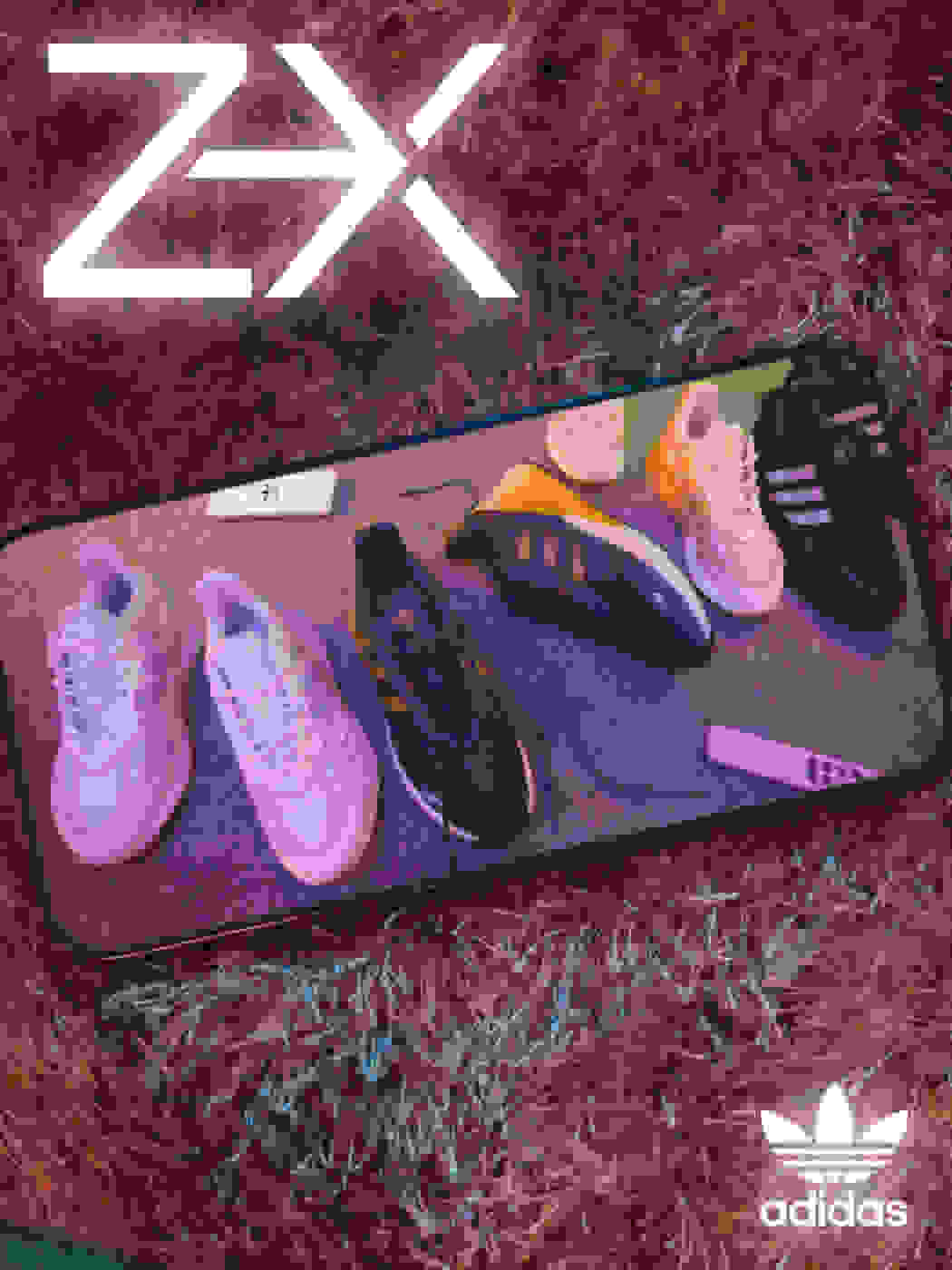 Scattered ZX shoes are seen on a cell phone screen that is lying on a carpet.