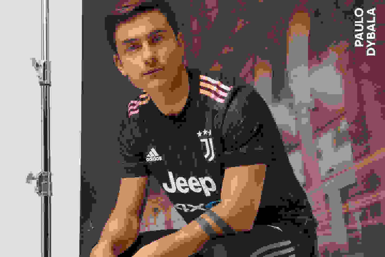 Male players wearing the Juventus Away Jersey