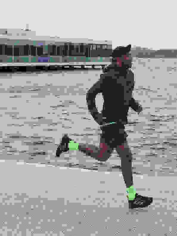 Side view of man running with the new adidas 4DFWD running shoe.
