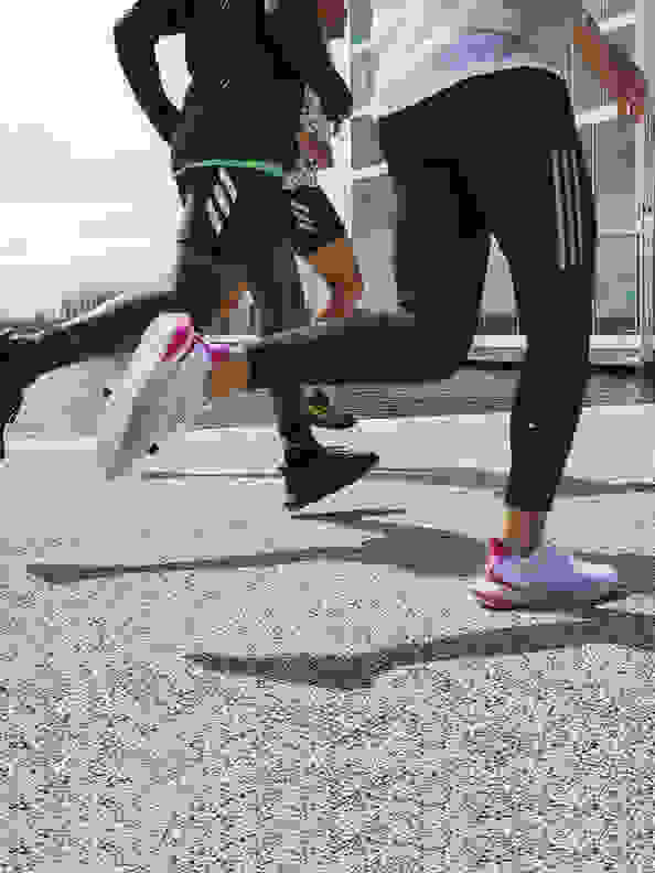 Woman and man running with the new adidas 4DFWD running shoe.