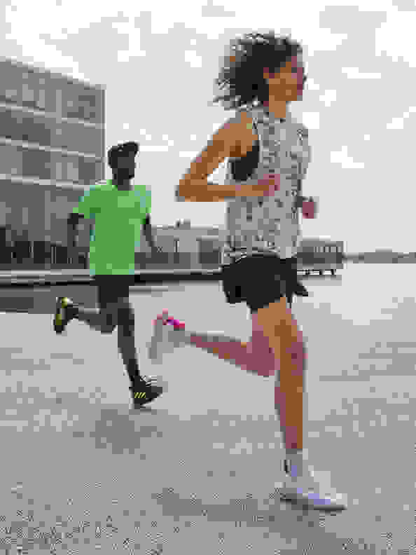 Side view of woman running with the new adidas 4DFWD running shoe.