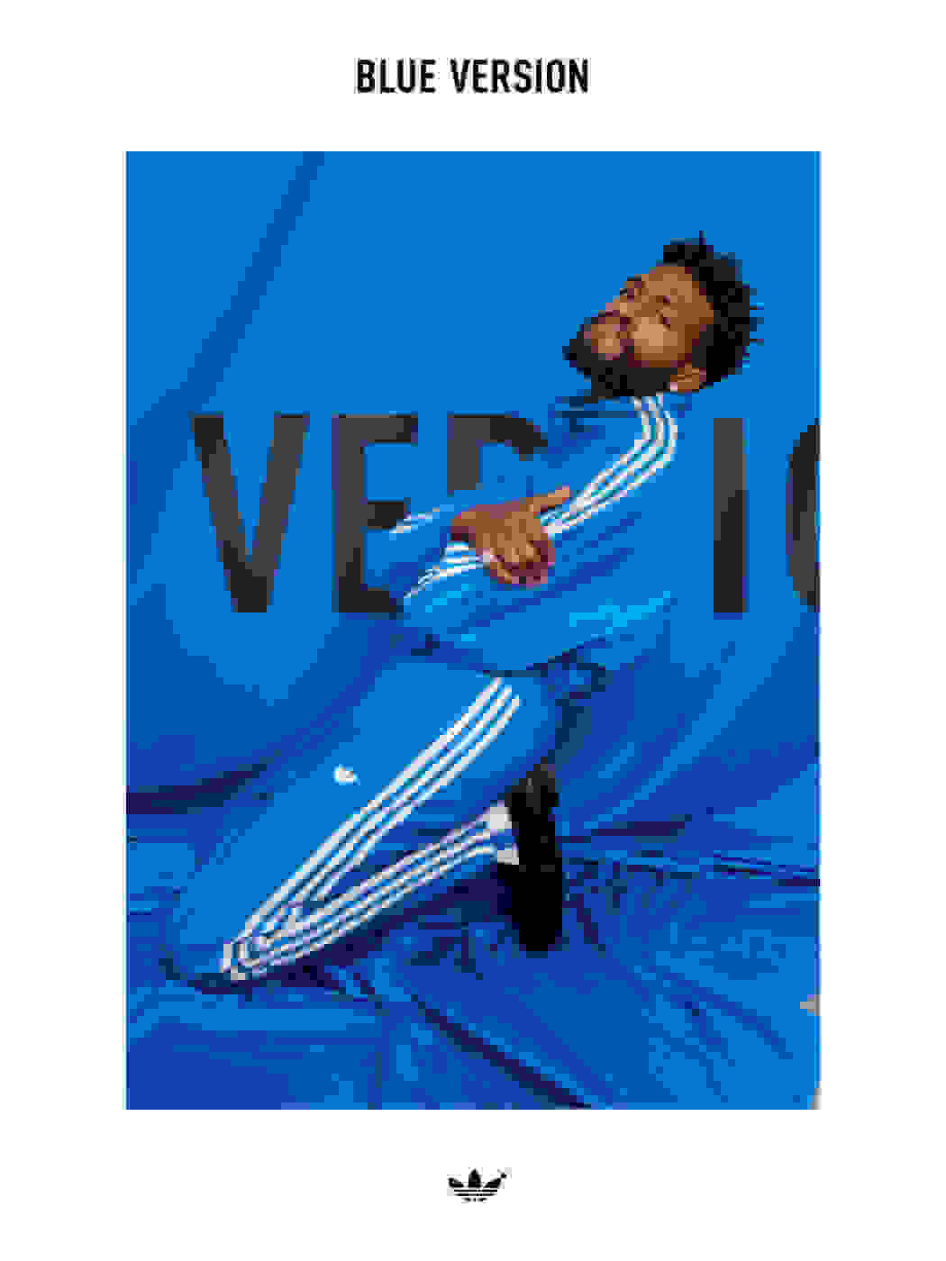Image of Duckwrth sitting on his knees wearing the Beckenbauer tracksuit in bluebird.