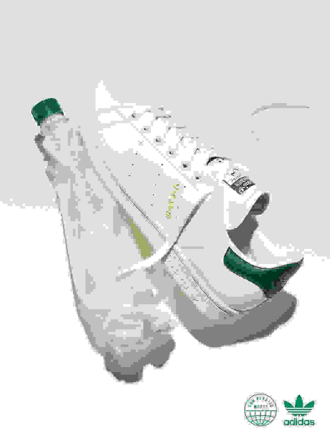 A Stan Smith shoe next to a crumpled water bottle on a white background. Next to it, a Stan Smith shoe with a bottle cap near the toe.