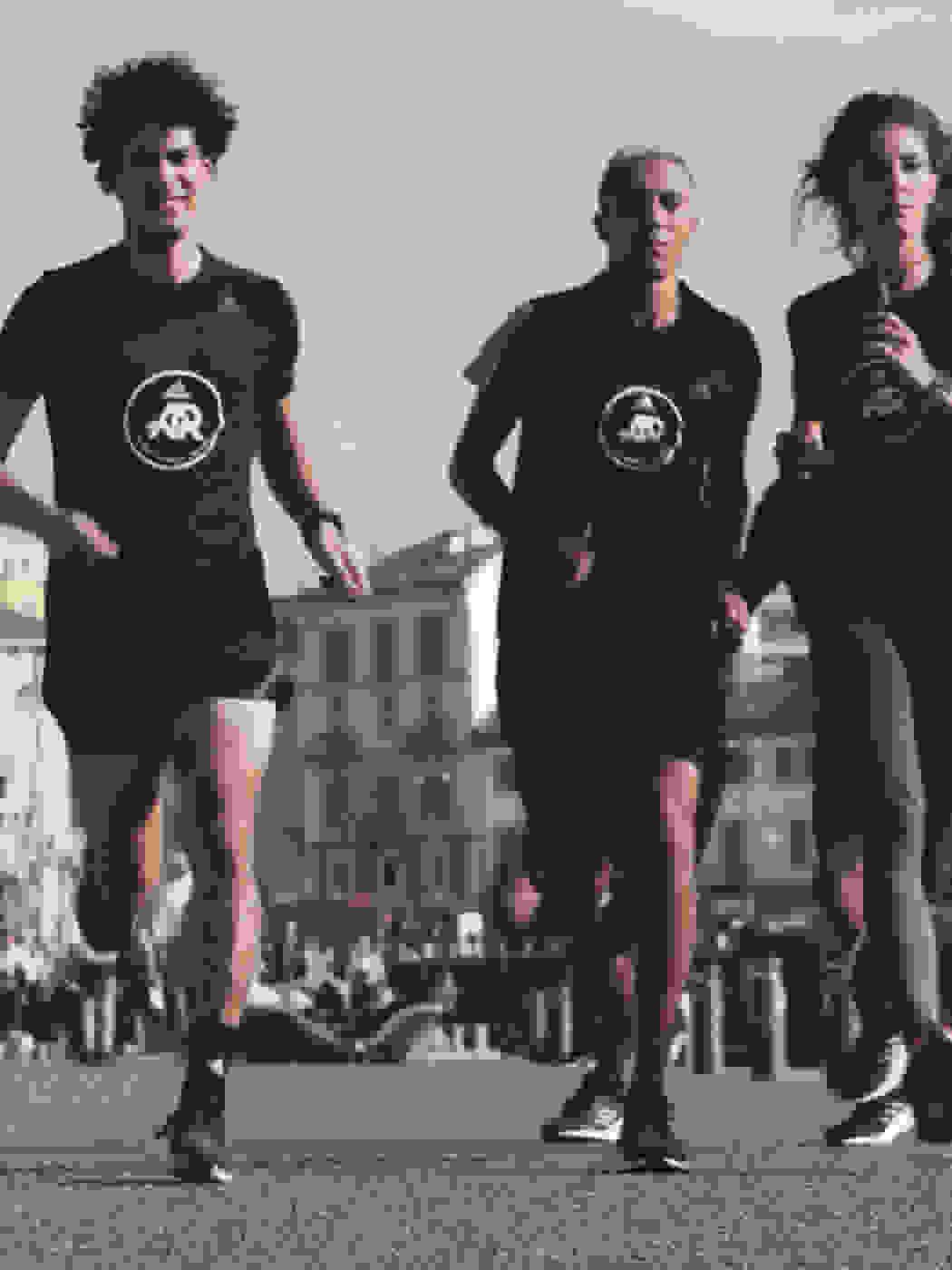 adidas runners Milano captain Paolo Bellomo leads a city run in the sinshine.