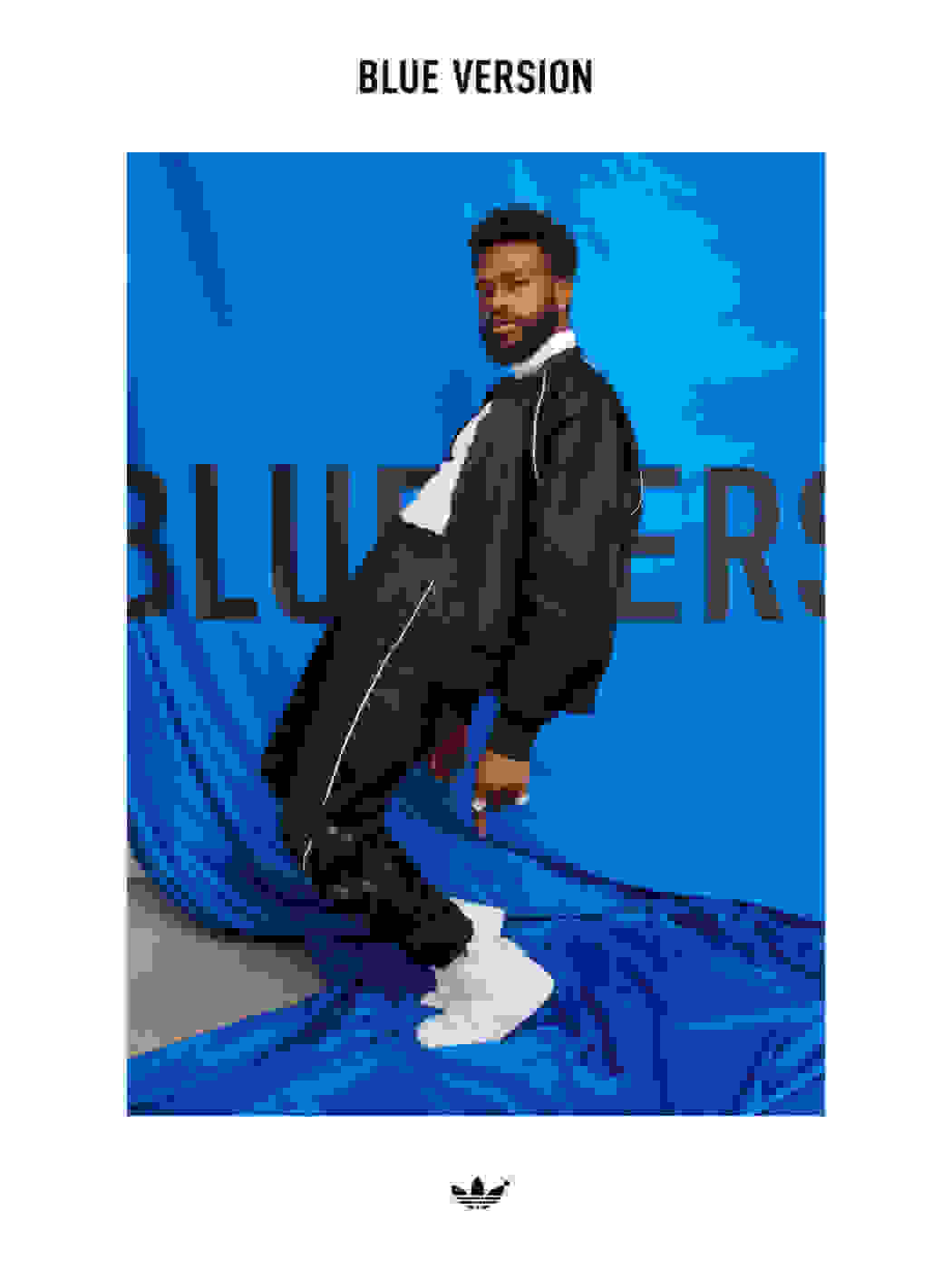 A full-body shot of Duckwrth backward-bending wearing a Blue Version Seefeld tracksuit in black.