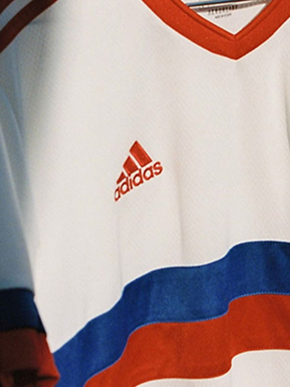 Close up of the team badge, woven into the chest.