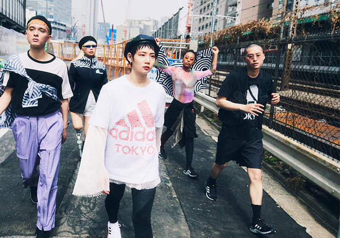 A group of young Tokyoites wearing items from HIROKO TAKAHASHI COLLECTION are walking along the street in Tokyo. Their energy is connected with each other and heading towards the same direction.