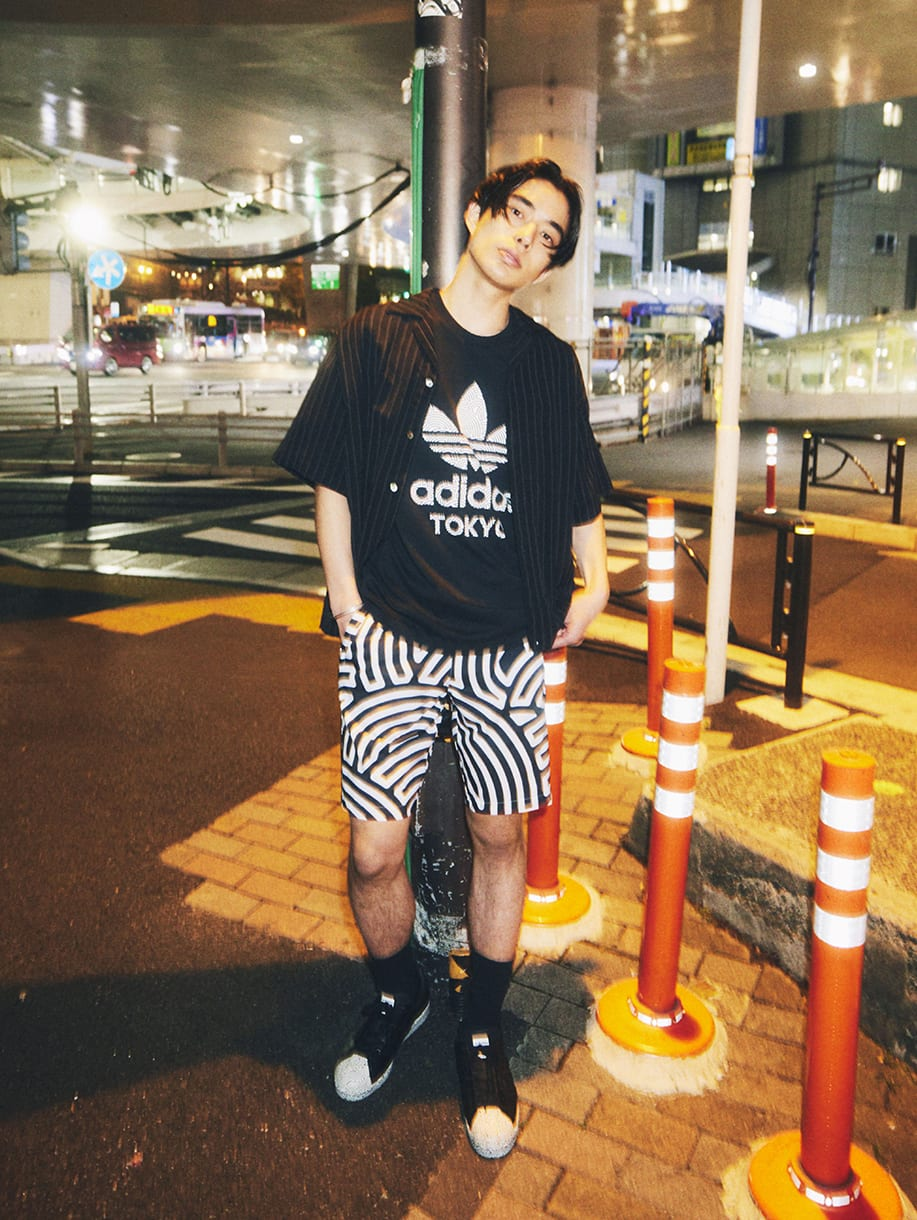 A young man wearing items from HIROKO TAKAHASHI COLLECTION.