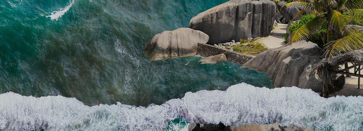 An ocean scene with a small rocky beach area
