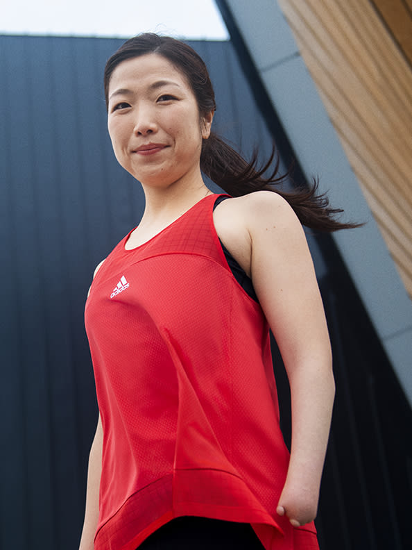 Frontal shot of woman wearing workout clothes