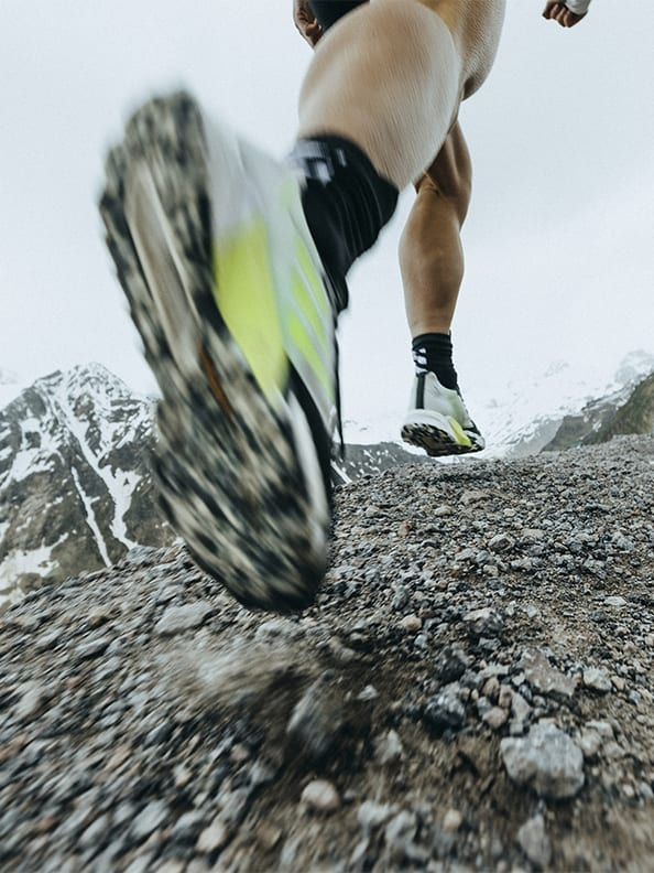 Athlete wearing the Agravic Ultra running up moutain trails