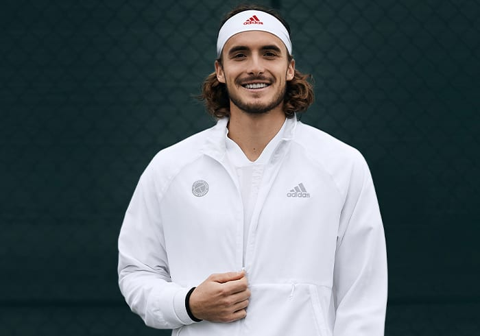 Male tennis player wearing the UNIFORIA jacket
