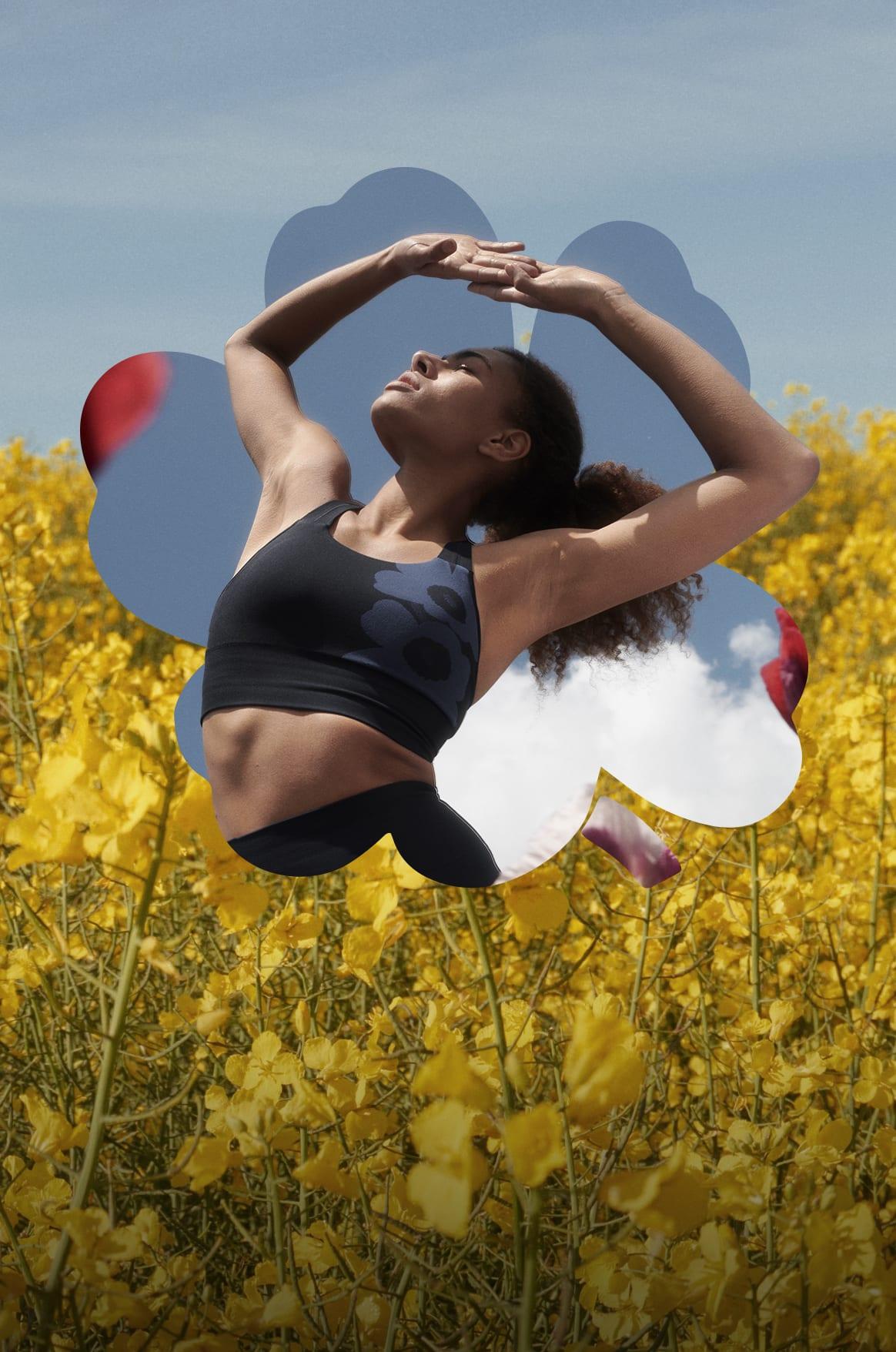 Female stretching in field wearing adidas marimekko