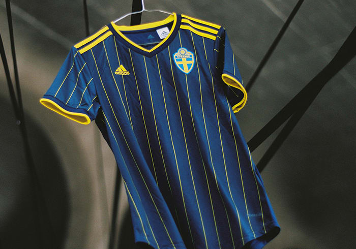 The new Sweden Away jersey is shown here. Its timeless design contrasts bright yellow stripes against an indigo backdrop.