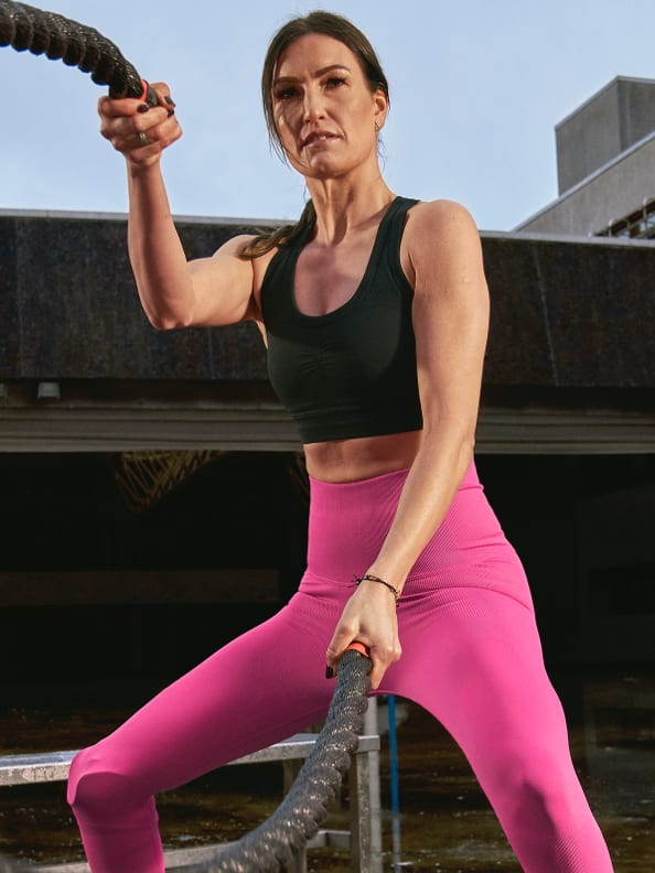 Denise Schindler wears the adidas Formotion Spring/Summer 2021 collection in Screaming Pink.
