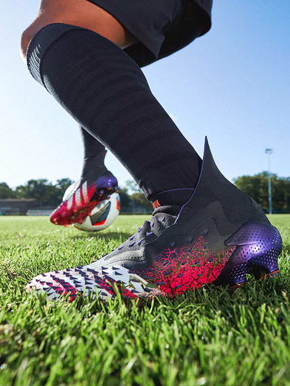 Action image featuring the Predator Boots.