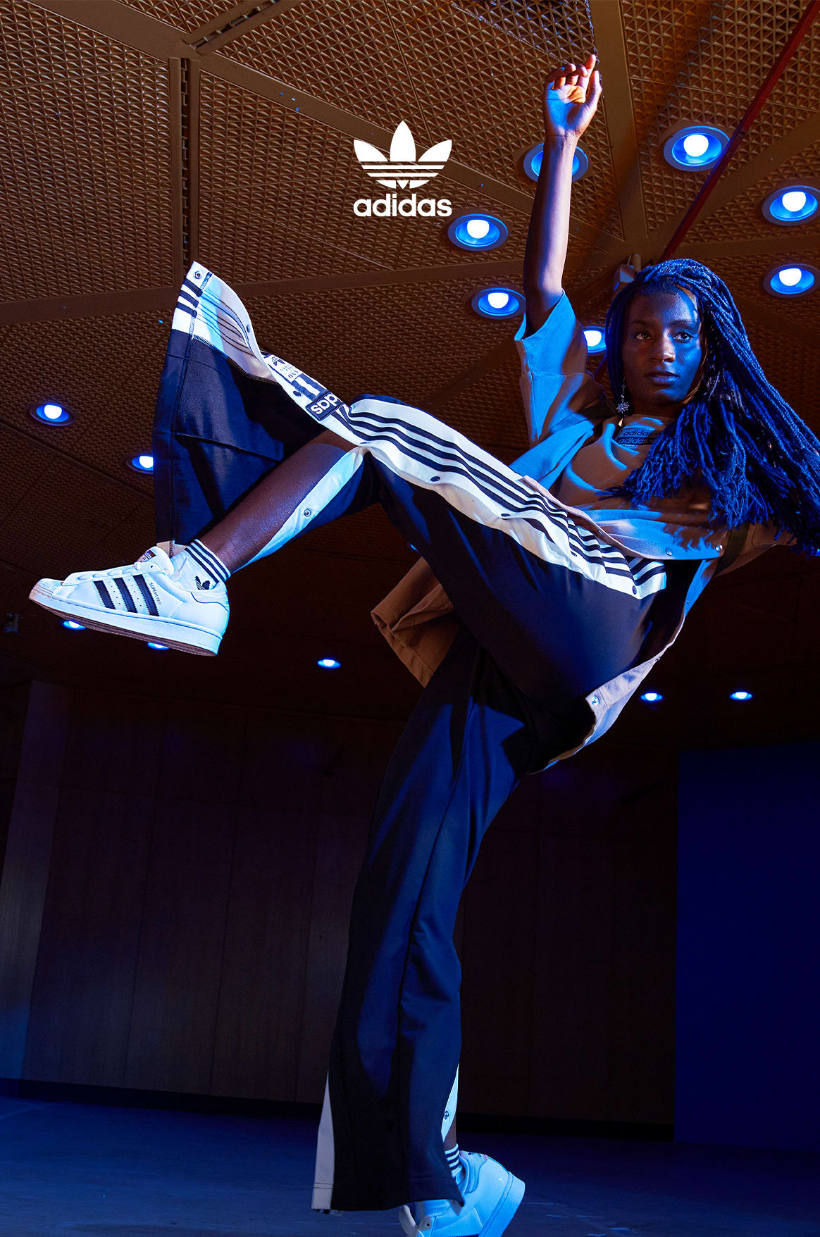 Oumi Janta dancing while wearing the new adidas Originals collection.