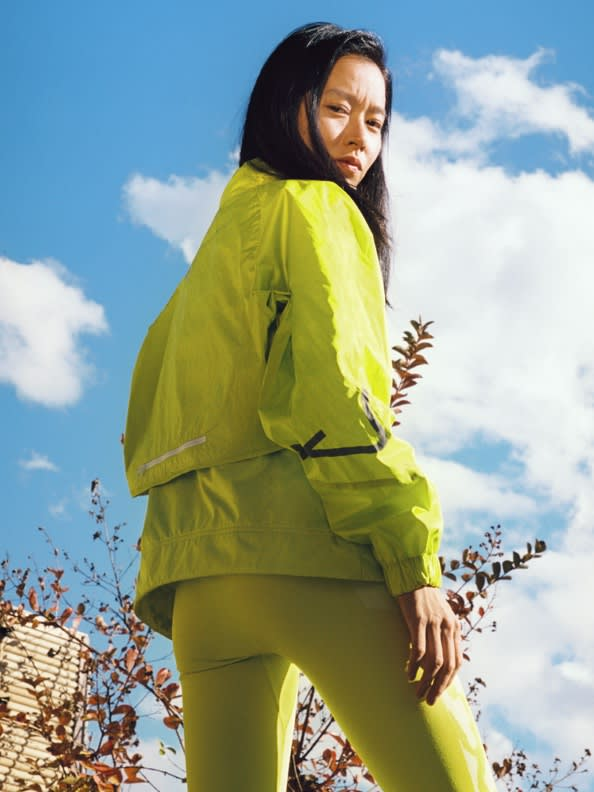 A collection of 3 images featuring the latest Workout Wardrobe drop from adidas by Stella McCartney.1. Leila Davis looks to camera wearing a white bra and pink leggings. 2. Nami Nagakura stands in all-yellow. 3. Leila Davis smiles wearing an all-grey look with a neon-accented bum bag.
