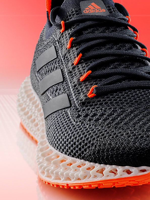 4DFWD adidas logo made from white lattices emerging from 3D printer