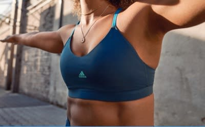 A close-up of a woman's chest, she is wearing a blue bra.