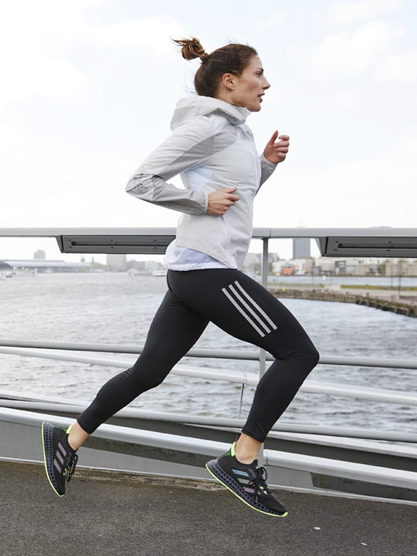 Close-up of woman running with her 4DFWD running shoes