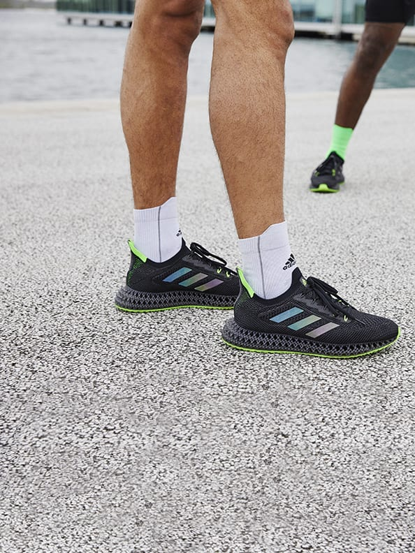 Close up of person running with the new adidas 4DFWD running shoe.