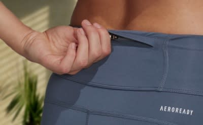 A close-up of the pocket detail in a pair of leggings.