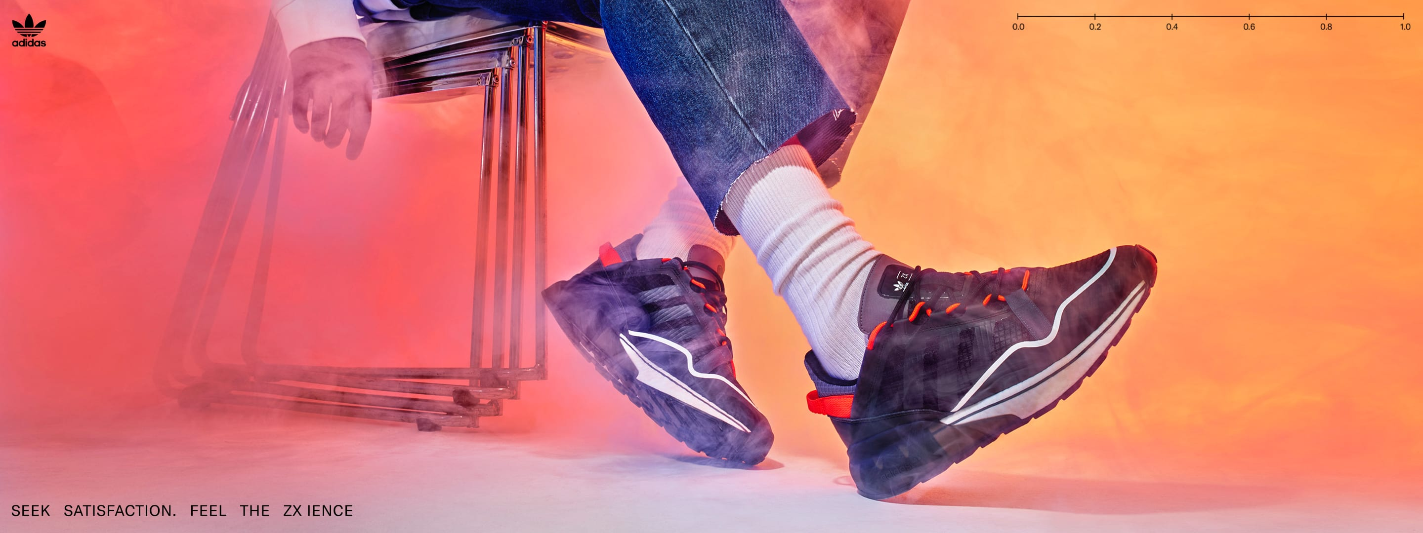 A close-up of a model wearing the ZX 2K BOOST PURE sneaker.