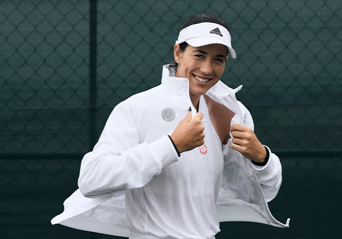 Female tennis player wearing the UNIFORIA jacket